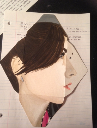 I don't have a lot of my art on my computer, but here's one. I took an art course in my last year of my undergrad and we had to do a self portrait on an envelope, so that is what this is.